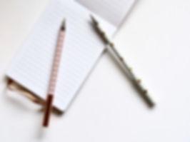 Twee Pennen op Notebook