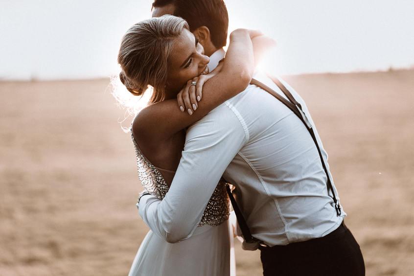 Bride hugging groom wedding spain