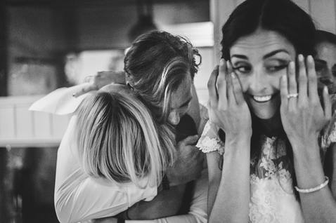 family crying at wedding