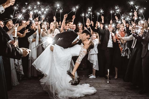 wedding couple kissing around sparklers