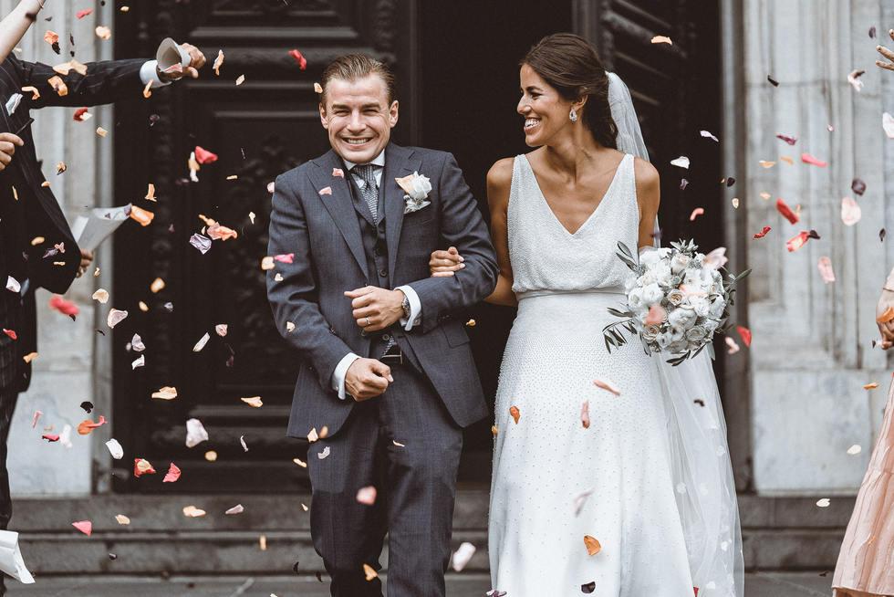 throwing flowers on bride and groom