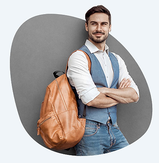 A man stands with his arms crosed, with a pre-loved bag on his shoulder.