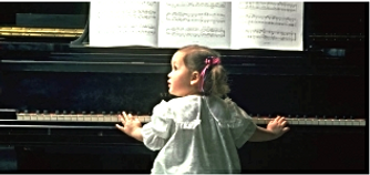 little kid playing piano