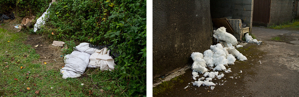 Left: White pillows, duvets and sheets are fly tipped in a grassy overgrown back lane. The photograph is on a diagonal to the pathway which leads the eye across the image. Right: This is a photo of a tarmac back lane with a concrete garage without a door. White duvet and pillow stuffing has been fly tipped on the ground which oddly looks like clumps of snow. Behind it and tucked in the doorway of the garage is a broken mattress and coffee table.