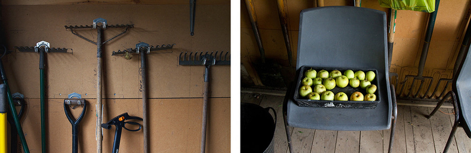 Left: This is a warm toned scene of the inside of a shed. Large and long tools are neatly hung upon hooks on a pale orange wall. Right: Another view from inside the same shed, this image featured a plastic grey chair with a large container full of green apples.