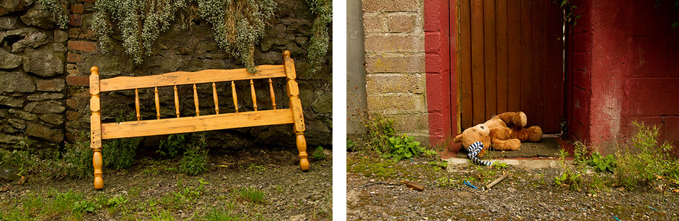 Left: In the centre of this image is a pale wooden headboard from a bed resting against a traditional dark stone wall. From the top of the wall hang bluey-green shrubs. Right: This is a photo of doorway to the back garden of a house.The wooden door is painted brown and the surrounding wall to the right is bright red. The door is ajar and a discarded child's teddybear lays on the floor. The toy is looking upwards to the sky. Detritus and weeds grow around the doorway entrance.