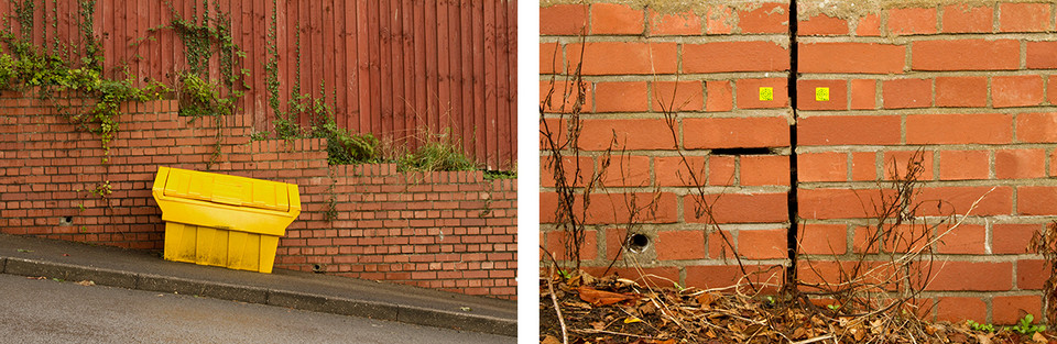 Left: These two images complement eachother in terms of tones, patterns and textures. The image on the left is of a red brick wall on a steep hill. The wall follows the curve of the road underneath downwards from left to right. Behind is a red wooden fence with vertical panelled lines. Green overgrown spills out from underneath the fence. On the pavement floor is a bright yellow grit box for use in the Winter months to melt the ice and snow. It too follows the steep shape of the hill and is on a diagonal slant. Right: This is a close up image of two red brick walls meeting with an inch in between. Some of the concrete holding the bricks is missing on the left and two yellow stickers have been placed above which work together to form a face. Dead weeds protrude from the cracks at the base of the wall.
