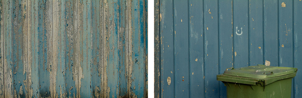 Both images are comprised entirely of two separate blue toned walls. The first on the left has paint peeling to reveal white underneath. This produces an intricate textured look. To the right is another painted wooden wall with a small white smiley face in the centre. The top of a green rubbish bin can be seen on the right side of the picture.