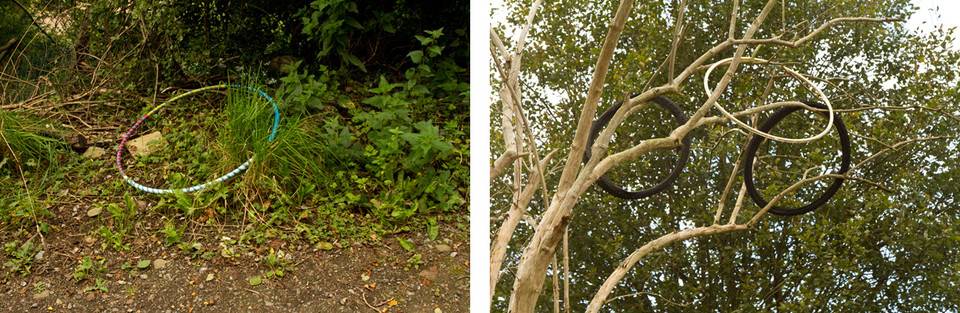 Left: Amongst grassy overgrowth to the side of a pathway is a discarded hula hoop in bright colours of blue, pink, white and yellow. Right: Three circular shapes made from two black bike wheels and a white inner tube of a bike wheel are caught high up in pale tree beaches.