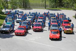 Gruppenfoto mit Autos