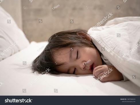 stock-photo-asian-little-child-girl-slee