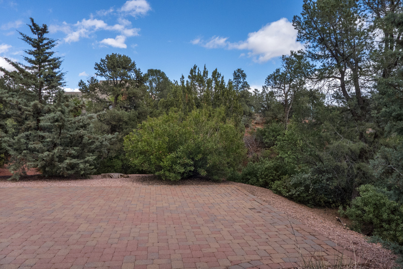 Common space to east of driveway