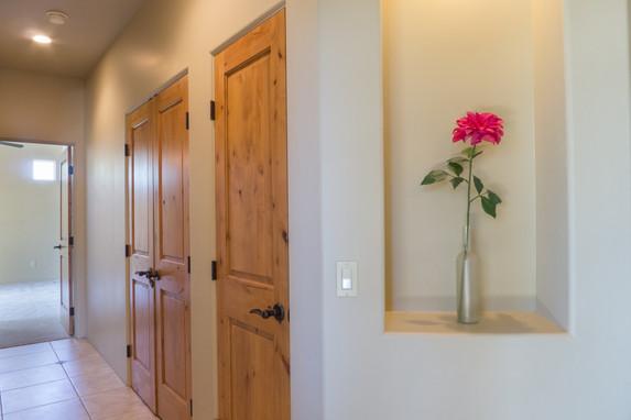 Hallway to guest bedroom suites