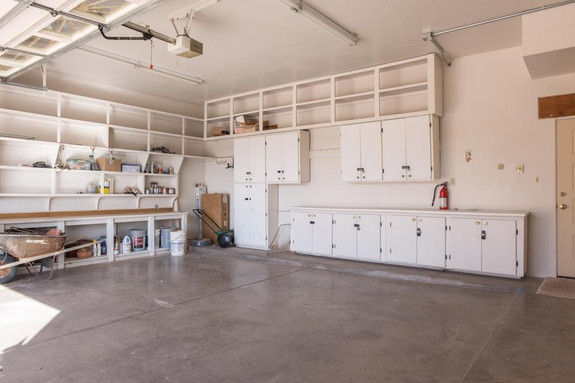 Lots of cabinets & shelves in garage