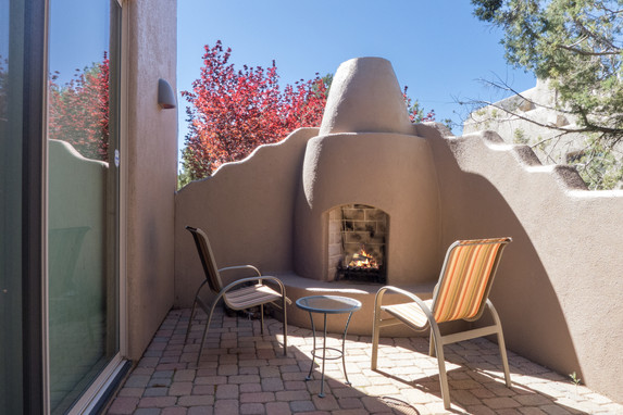 Kiva fireplace in front courtyard