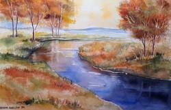 Syysvärejä joen rannalla