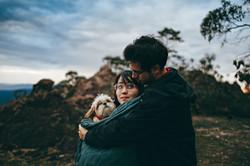 couple-hugging-adult-tan-and-white-shih-