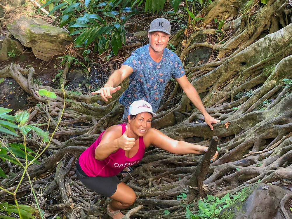 Private guide Demian Deas and Terri Miller climbing Banyan tree