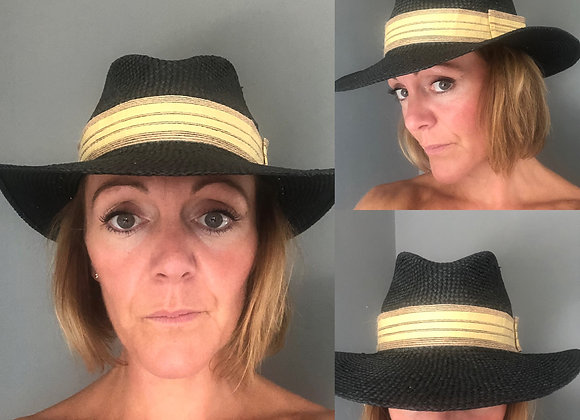Black straw hat with light neutral hessian band