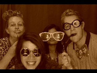 four freinds in a photo booth