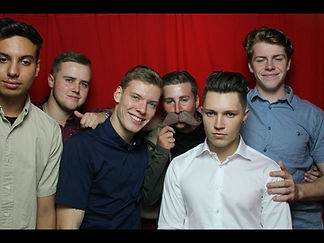 group of men in a photo booth