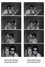 Two People in a Photo Booth