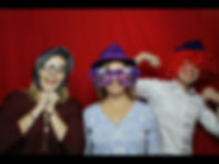 three people in a photo booth
