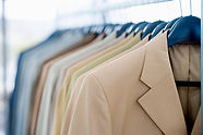 suit jackets in a well organized closet