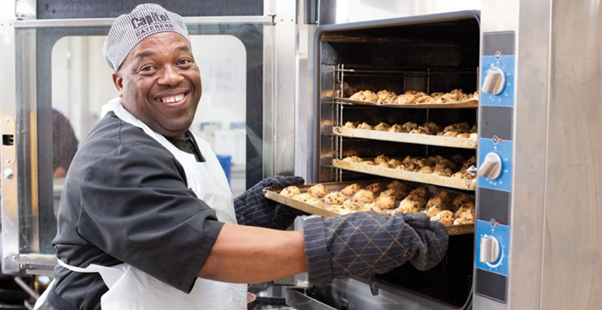 Thulani Mnguni prepares another batch of Capitol Caterers signature biscuits
