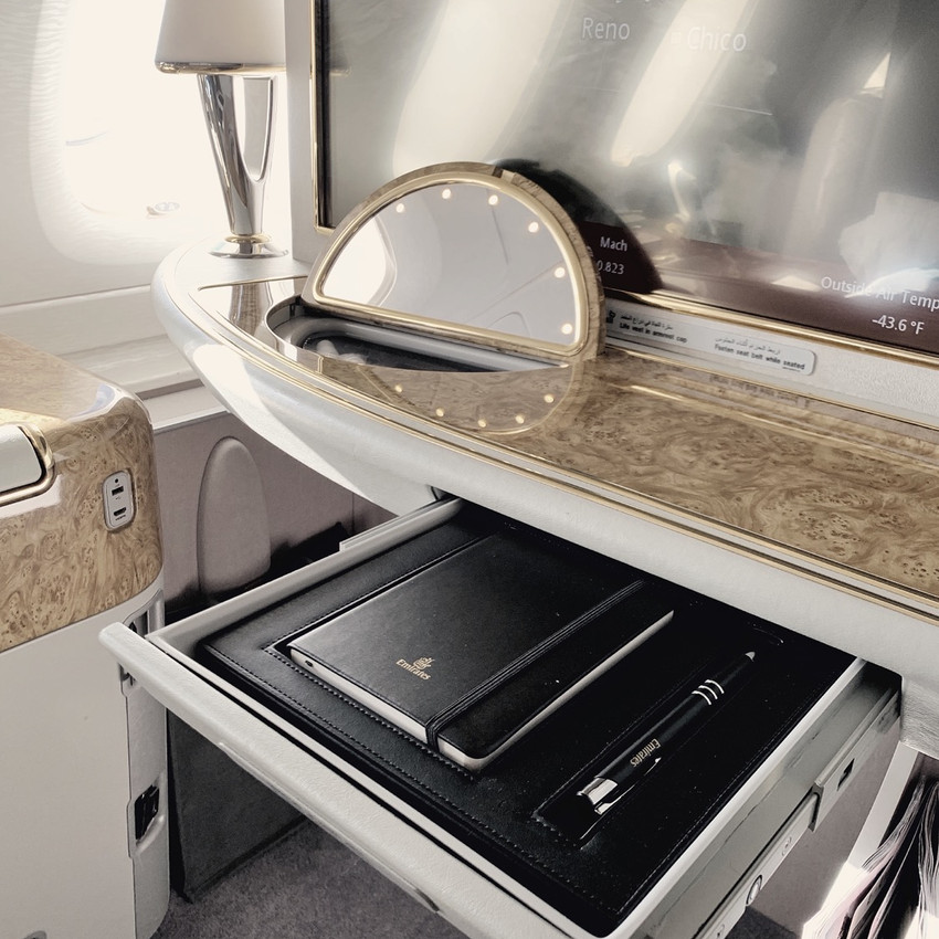 Every seat of the Emirates First Class A380 Cabin comes with a stationary kit and vanity station with toiletries.