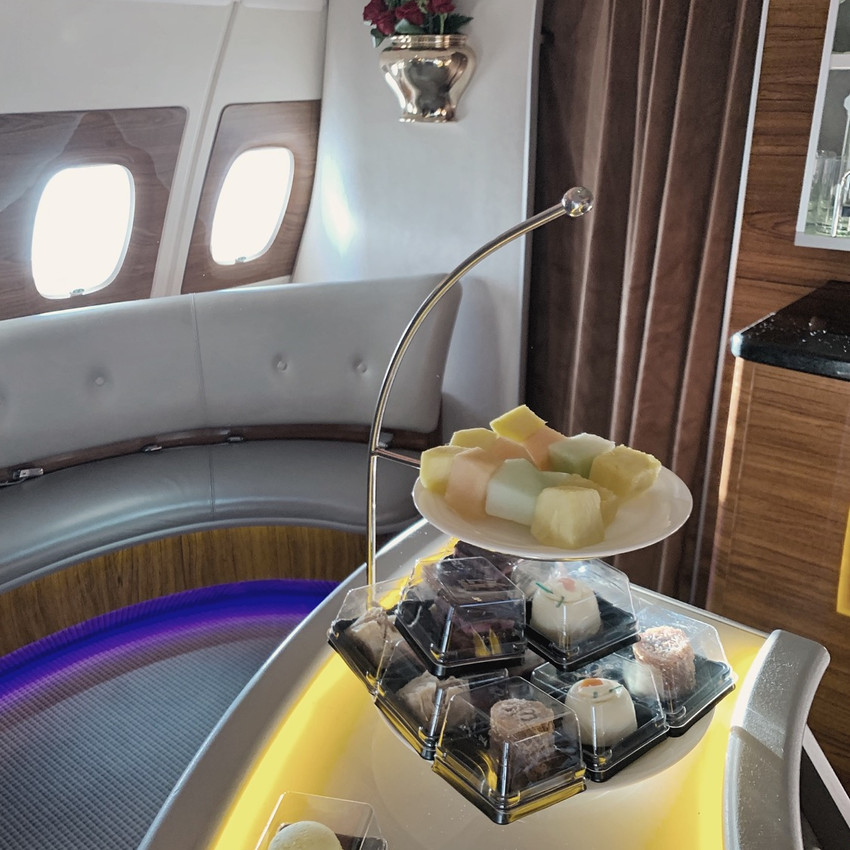 The Emirates Flagship A380 Onboard Bar offers small snacks and treats while you socialize.