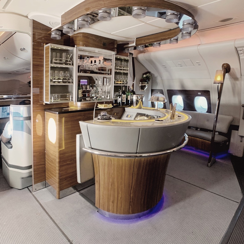 The Emirates Flagship A380 Onboard Bar is located directly behind the  upstairs Business Class cabin.