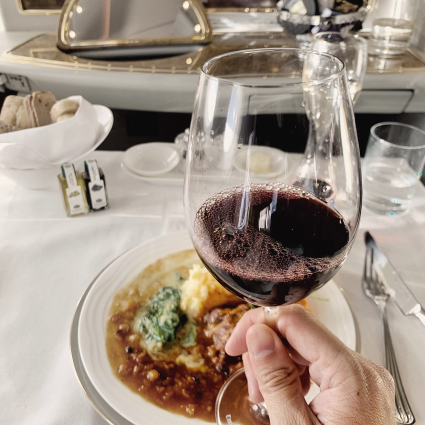 The crew recommended I pair my main dish with a glass of the French Chateau Montrose 2005, a red wine which retails for $300 per bottle.