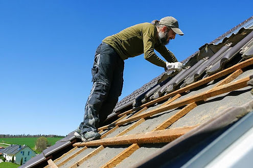Corona California roofing services work being done by a handyman