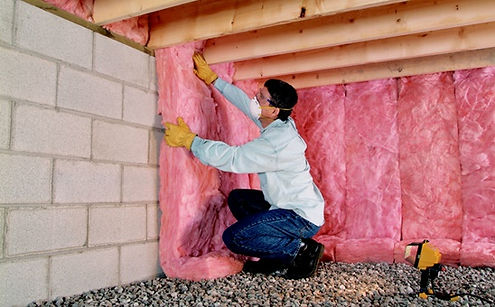 insulation expert working on crawl space