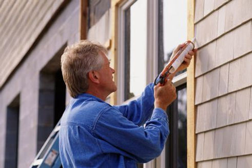 insulation expert working on windows and doors insulation services in Baltimore, MD