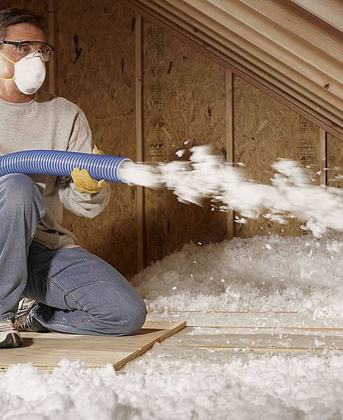 insulation expert working on cellulose insulation