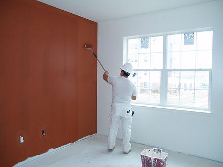 painter working on interior painting ser