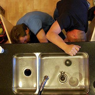 team of handymen working in Corona California on plumbing services