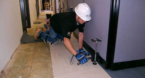 Mobile Alabama flooring services being done by a team of handymen