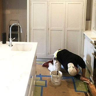 team of handymen working in Corona California on painting services