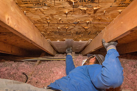 insulation expert working on attic insulation service in Indianapolis Indiana
