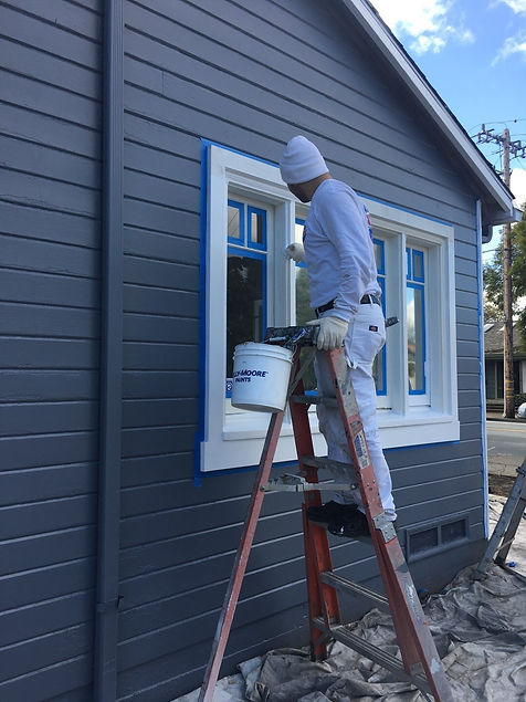 painter working on exterior painting ser