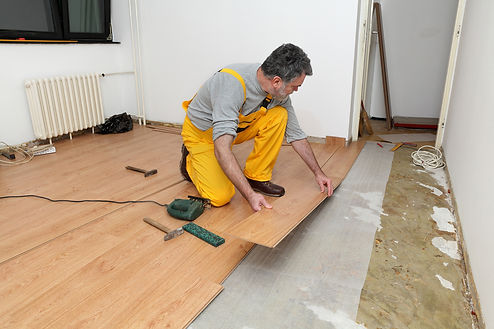 Corona California flooring service being done by a team of handymen