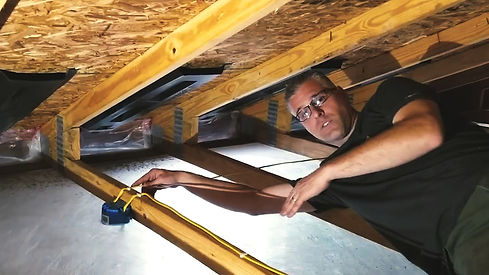 insulation expert working on blown in insulation services in Baltimore, MD