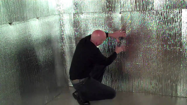 insulation expert working on wall insula