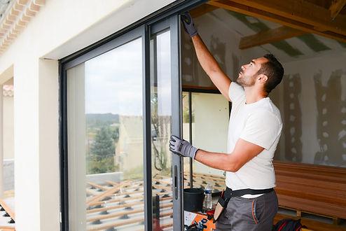 handyman working on window services in H