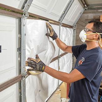 insulation expert working on garage insulation