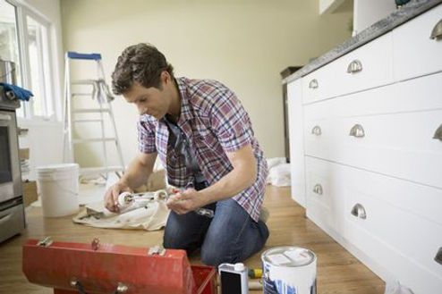 Corona California painting services work being done by a handyman