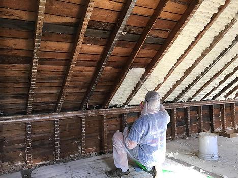insulation expert working on spray foam